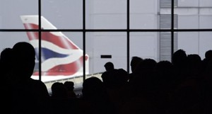 A British Airways aircraft is pictured as pass...