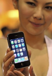 A model shows a 3G iPhone during its launch an...