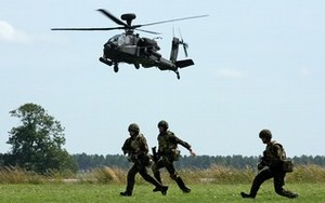 An AH-64 Apache helicopter takes part in a mis...
