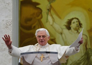 Pope Benedict XVI waves as he blesses the pilg...
