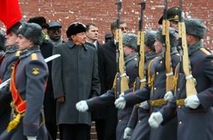 Cuban President Raul Castro (C) reviews marchi...