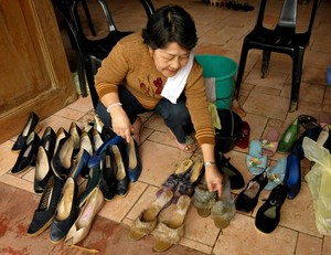 Museum official Sylvia de la Cruz 73, cleans s...