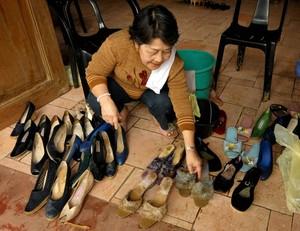 Museum official Sylvia de la Cruz 73, cleans s...