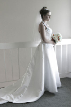 A bride in a very traditional long white weddi...