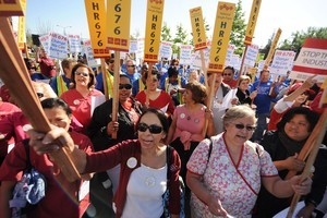 Nurses and other healthcare activists rally fo...